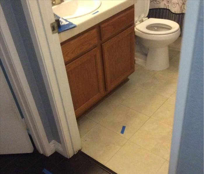 water loss in hall bathroom, floor damaged