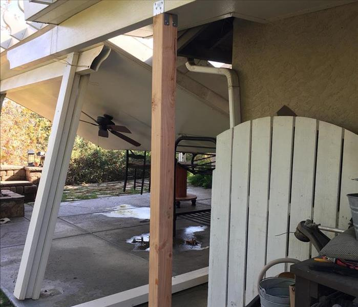 collapsed patio from storm